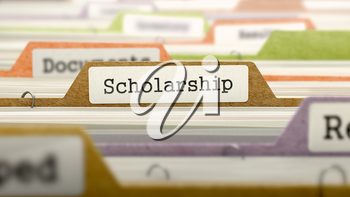 File Folder Labeled as Scholarship in Multicolor Archive. Closeup View. Blurred Image.