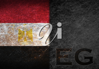 Old rusty metal sign with a flag and country abbreviation - Egypt