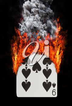 Playing card with fire and smoke, isolated on white - Nine of spades