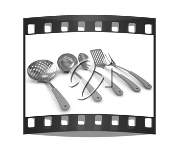 Gold cutlery on a white background. The film strip