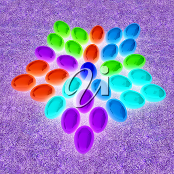 Colored Easter eggs as a flower on a grass