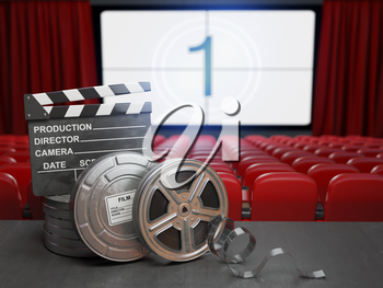 Cinema, movie or home video concept background. Film reels and clapper board in the theater movie cinema screen with empty seats. 3d illustration