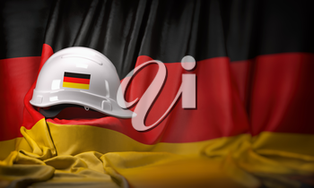 White hard hat laying over Germany flag. Construction and employment in Germanyconcept, . 3d illustration