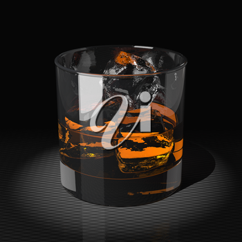 Whiskey with ice cubes in a tumbler glass. Dark key. Close up shot on black background.