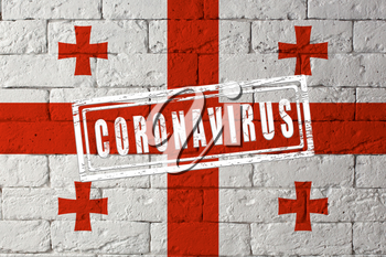 Flag of the Georgia with original proportions. stamped of Coronavirus. brick wall texture. Corona virus concept. On the verge of a COVID-19 or 2019-nCoV Pandemic.