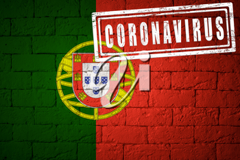 Flag of the Portugal with original proportions. stamped of Coronavirus. brick wall texture. Corona virus concept. On the verge of a COVID-19 or 2019-nCoV Pandemic.