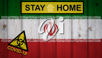 Flag of the Iran in original proportions. Quarantine and isolation - Stay at home. flag with biohazard symbol and inscription COVID-19.