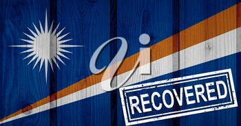 flag of Marshall Islands that survived or recovered from the infections of corona virus epidemic or coronavirus. Grunge flag with stamp Recovered