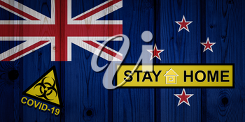 Flag of the New Zealand in original proportions. Quarantine and isolation - Stay at home. flag with biohazard symbol and inscription COVID-19.