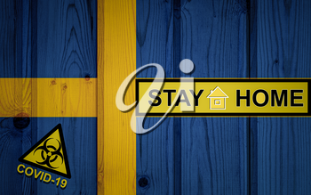 Flag of the Sweden in original proportions. Quarantine and isolation - Stay at home. flag with biohazard symbol and inscription COVID-19.