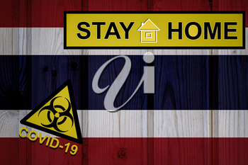 Flag of the Thailand in original proportions. Quarantine and isolation - Stay at home. flag with biohazard symbol and inscription COVID-19.