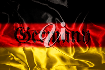 German flag blowing in the wind With Germany Written On It In Gothic Letters